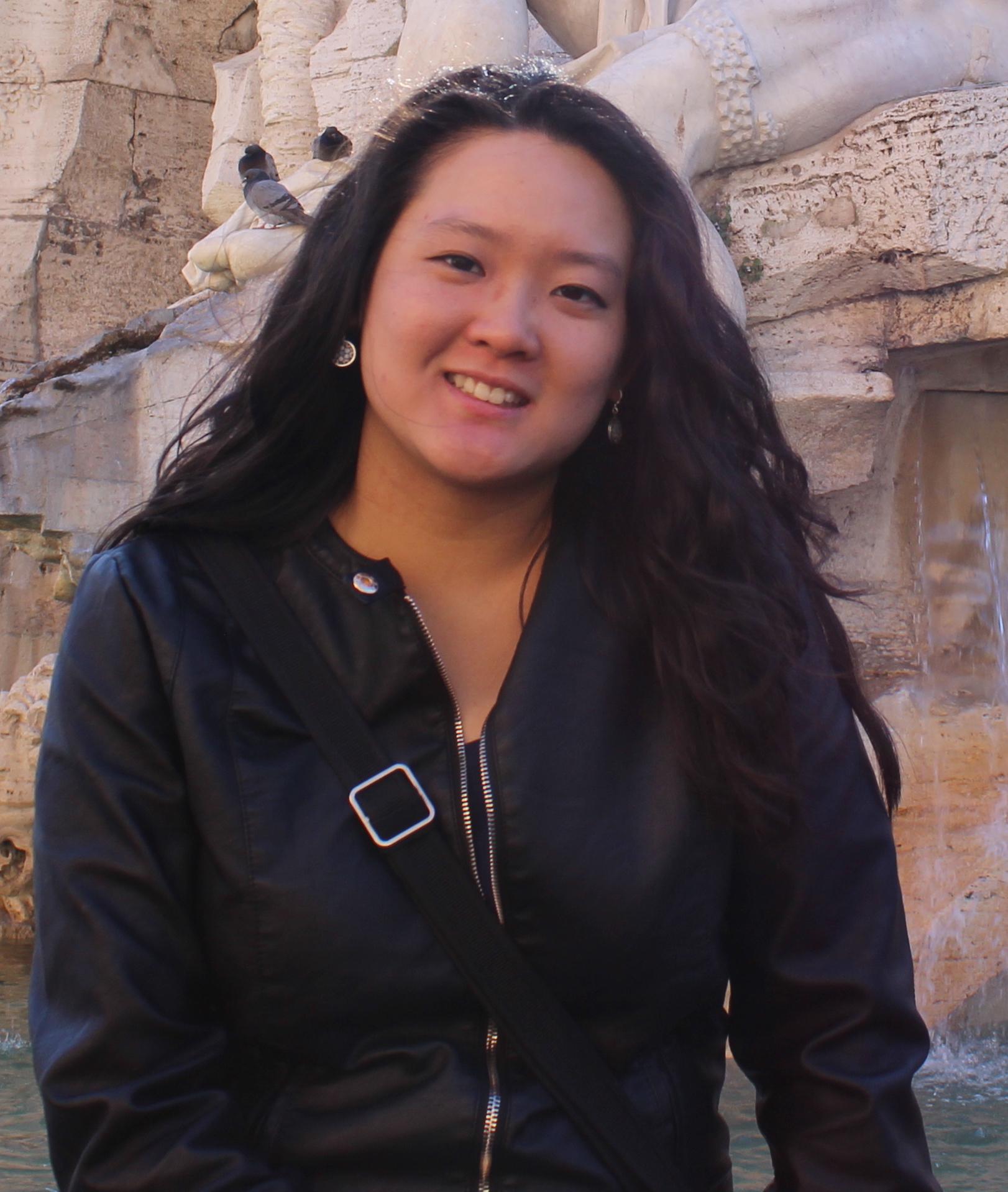 Woman with dark long hair smiling at camera